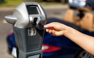 Put money in someone's parking meter
