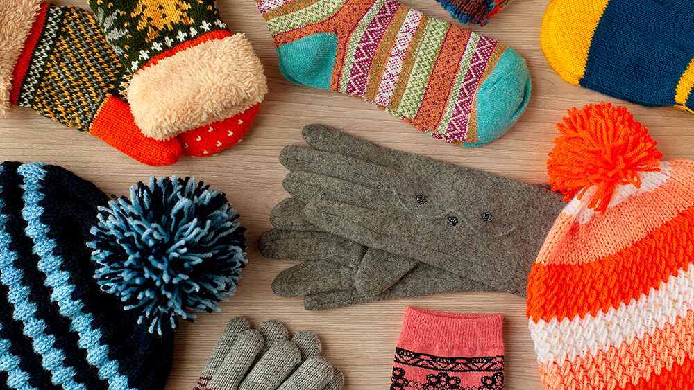 Pass out socks and winter gear to homeless people