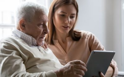 Teach a senior citizen to use a feature on their phone or computer